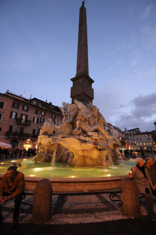 Piazza Navona fountain of Four Rivers in the evening
