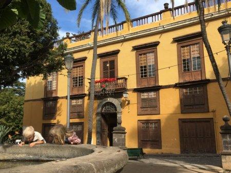 Examining an Icod de los Vinos fountain, Tenerife