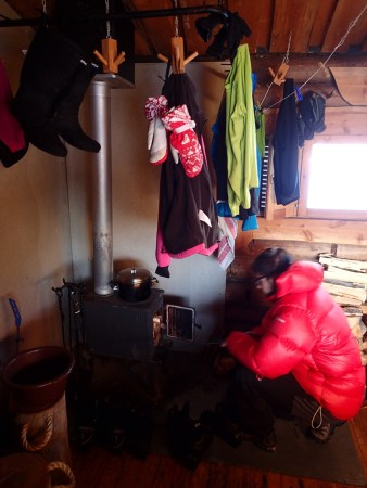 Ski tour in Lapland, drying clothes in the hut