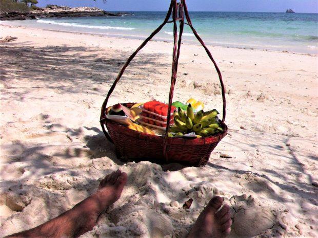 Enjoying tropical fruit on the best Ko Samet beaches