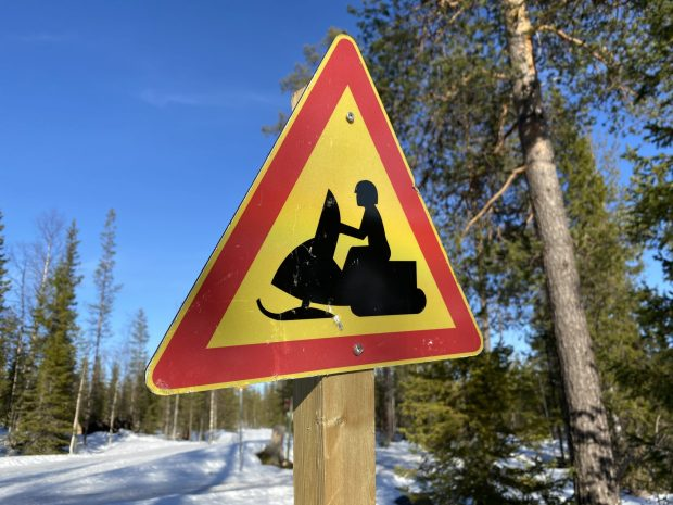 Arctic Lapland spring: snowmobiling in the wild