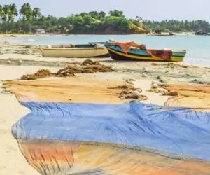 Fishing boats and nets on the beach north of Trincomalee, on the eastern coast of Sri Lanka.