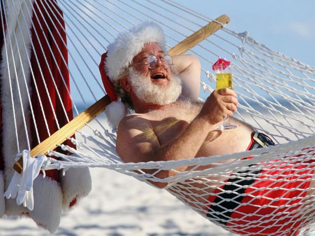 Santa in a Hammock copyright Wallpaper Shop