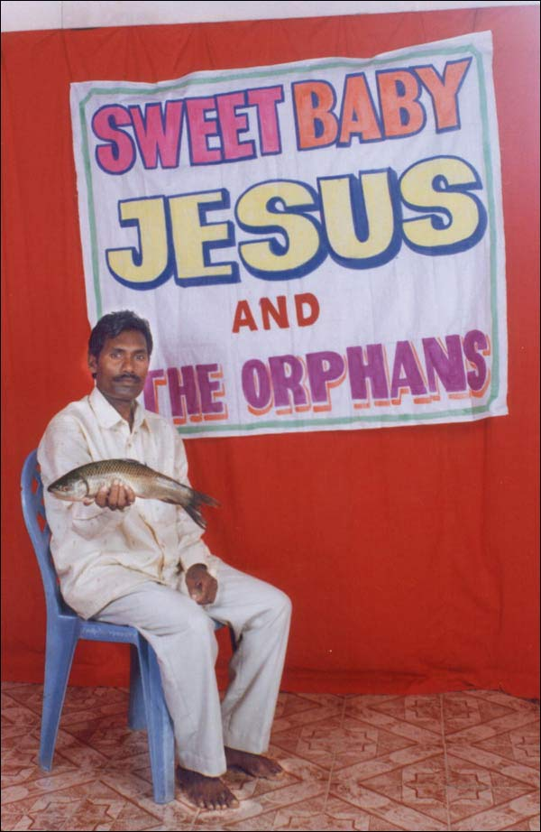 Sweet Baby Jesus and the Orphans Sign - Indian Man Holding Fish - Scambaiting Prank