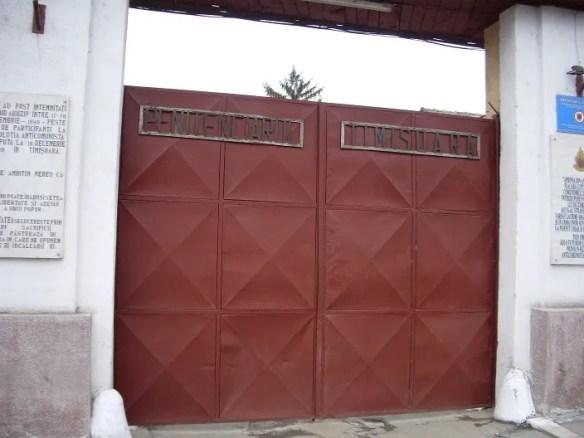 Popa Şapcă Jail, Timişoara, Romania (2006). Two bizarre inscriptions in marble flank the entrance