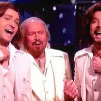 The Real Barry Gibb Appears On The Barry Gibb Talk Show: The Symbolism Of It All + What He Was Wearing Around His Neck