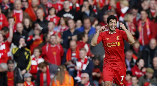 Liverpool's Suarez celebrates after scoring his second goal during their English Premier League soccer match against West Bromwich Albion at Anfield in Liverpool