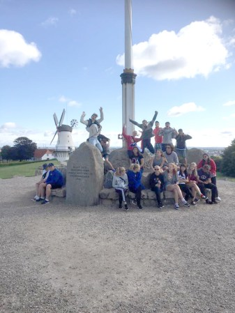 The whole group at a war memorial