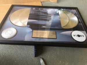 "Royal Heir Entertainment platinum plaque for Drake ""views"""