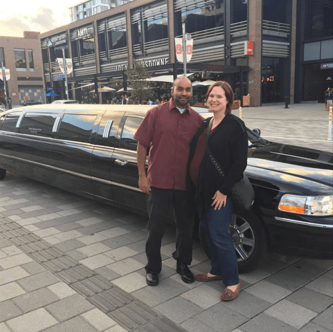 couple standing beside black limousine