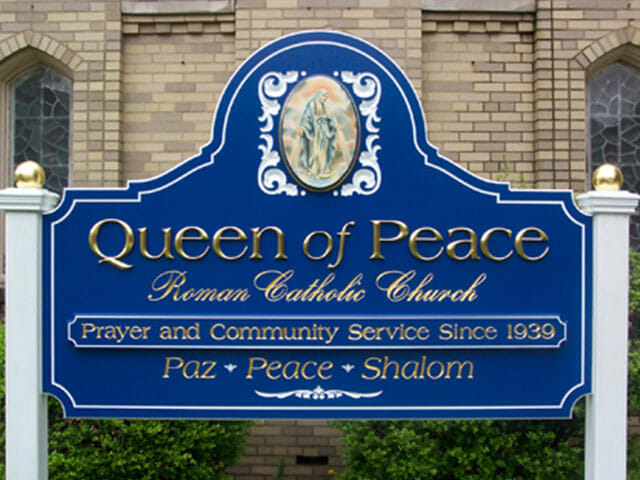 Carved Sign for Queen of Peace Roman Catholic Church