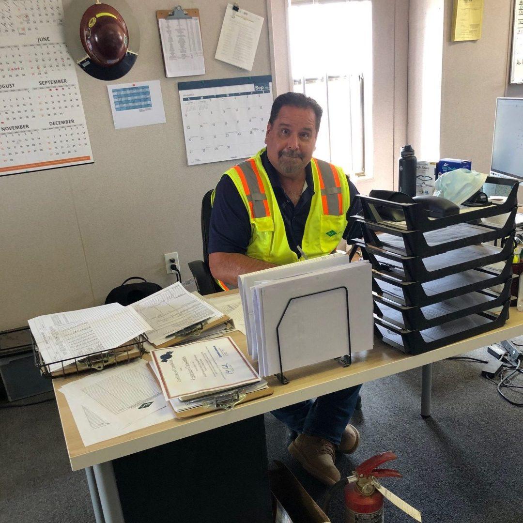 Employee sitting at desk.