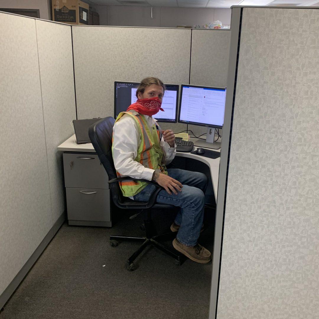 Employee at jobsite trailer.