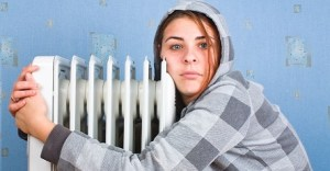 The freezing girl about a heater