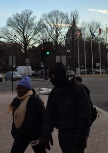 Commuters brave winds outside Union Station, Washington, D.C., yesterday.