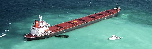 Oil is seen next to the 230m-long bulk coal carrier Shen Neng I about 70 km east of Great Keppel Island