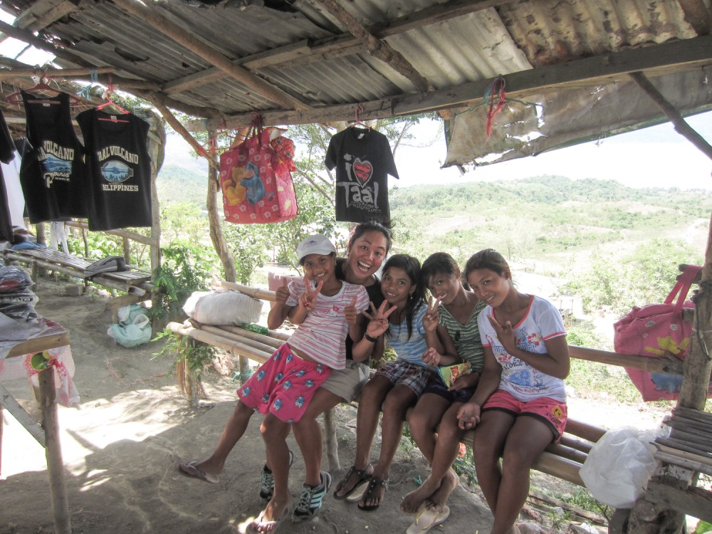 With locals at Taal