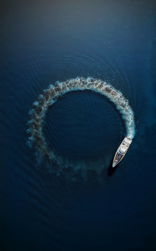 boat sailing in a circle