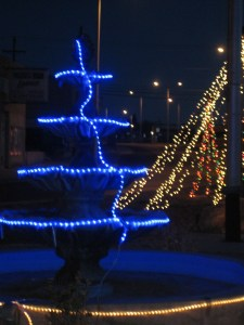 Blue lights on fountain.