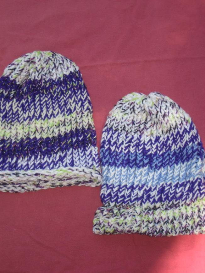 These primarily purple and green hats cost $13, including shipping. The one on the left has a rolled edge. The one on the right has a finished edge.