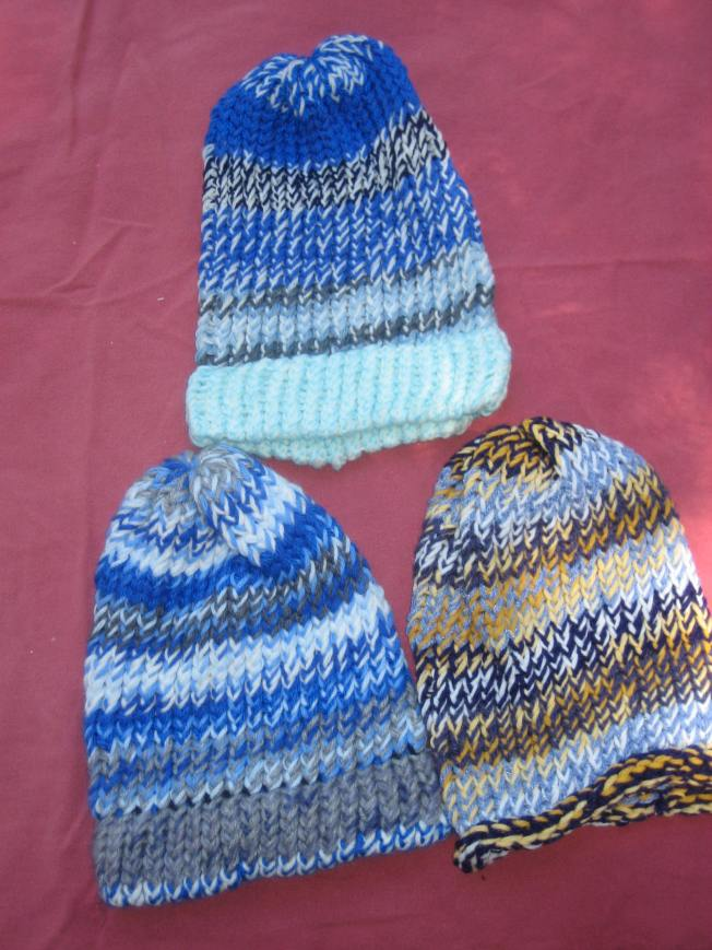 These primarily blue hats cost $13 each, including postage. The one on the bottom right has a rolled edge. The other two have finished edges.