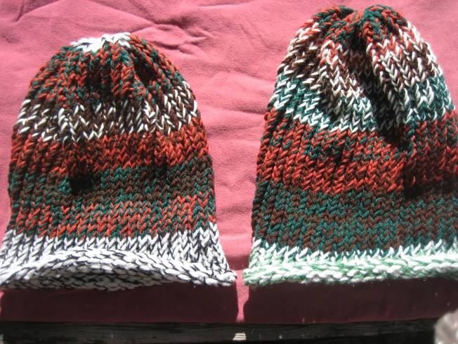 These hats were also made using the largest loom I have. They would be great for folks with large heads and/or lots of hair. Each has a rolled edge and features autumn colors--browns, dark greens, and rusty oranges. Each hat costs $13, including shipping.