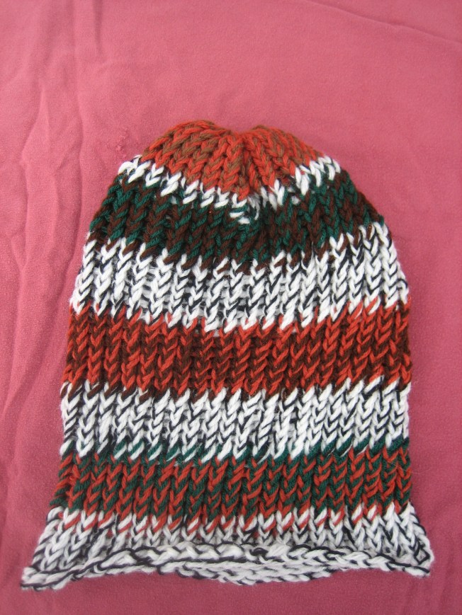 I made this hat before I left the forest in October, but it just resurfaced when I cleaned the van. It is an extra large and has a rolled edge. It costs $13, including postage.
