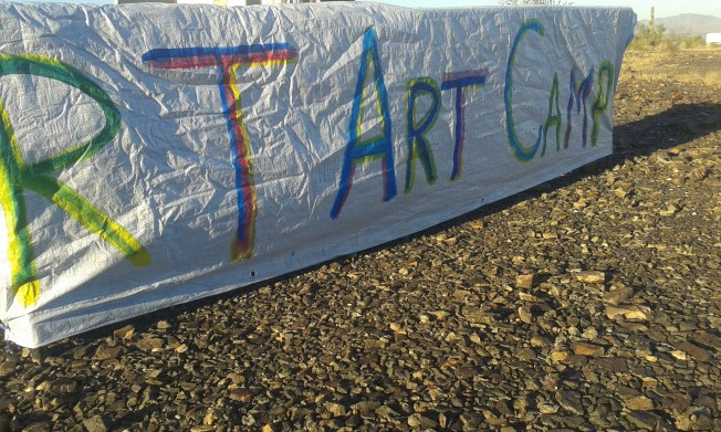 "White banner reads ""R T Art Camp"" in multicolored letters."