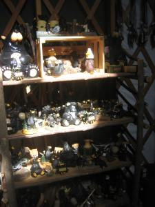 Breakable bear figurines sit on a shelves, a shaft of sunlight illuminating them.
