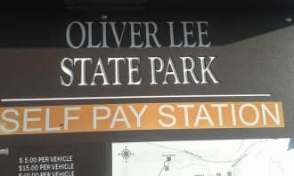 Sign reads Oliver Lee State Park Self Pay Station.