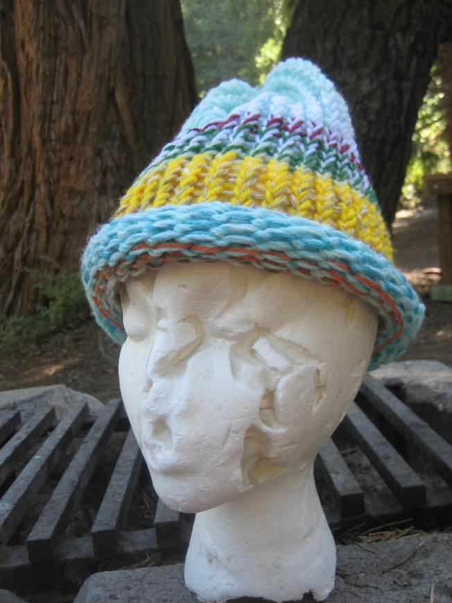 Styrofoam head mannequin wears a bright, handmade hat