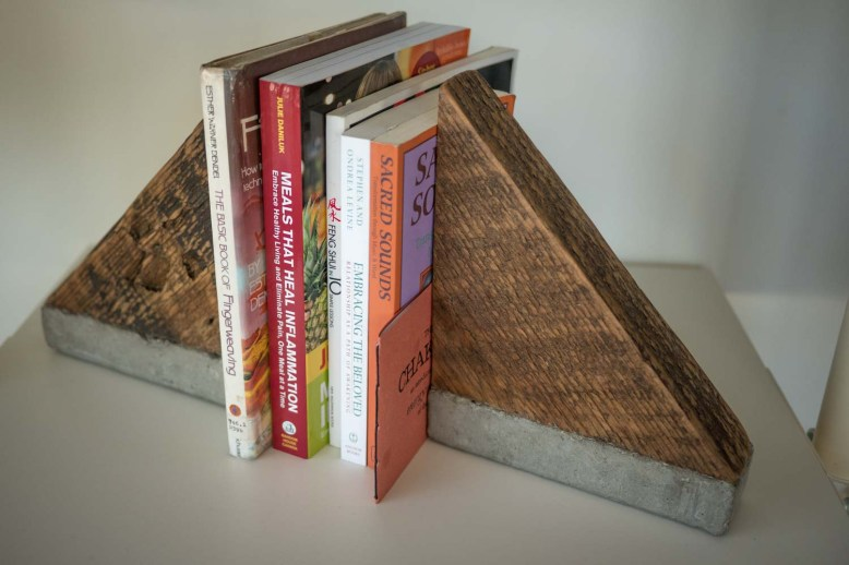 Bookends: Learning over systems. Salvaged reclaimed Fir offcuts fused to concrete to create bookends.