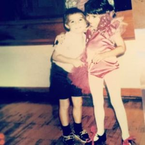 I am always ready for the lights and stage again! A throwback to me with my little brother!