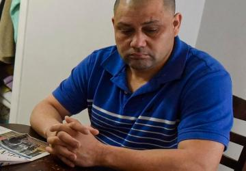 Eleazar Lopez Ayala sits at the kitchen table in his Manchester home last month.
