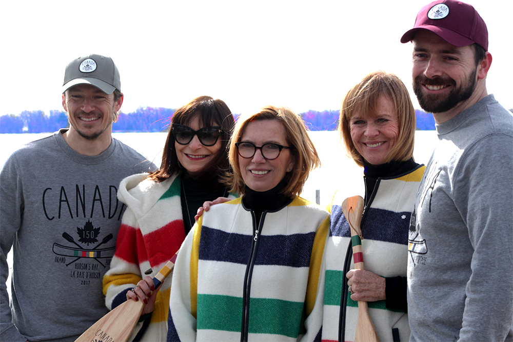 Simon Whitfield, Jeanne Beker, Liz Rodbell, Valerie Pringle and Mark Oldershaw outside of Harbourfront Centre in Toronto and taking a photo op infront of the Toronto Islands