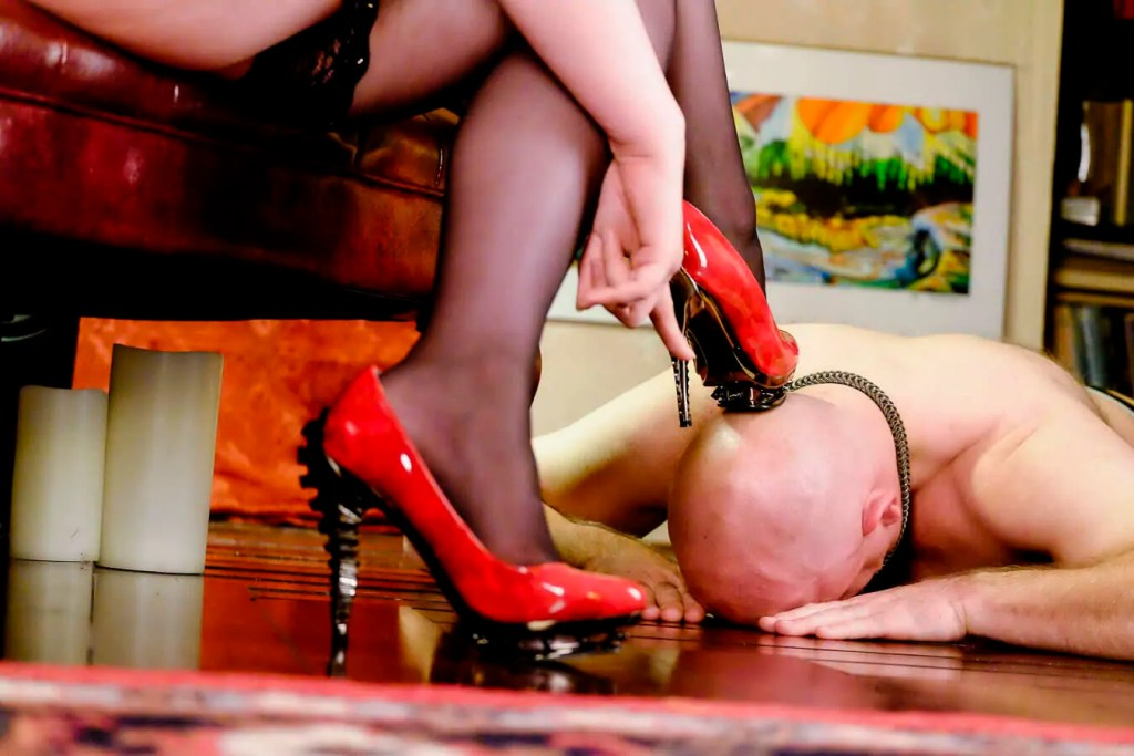 Dominatrix Ruby in Her Dungeon with her slave