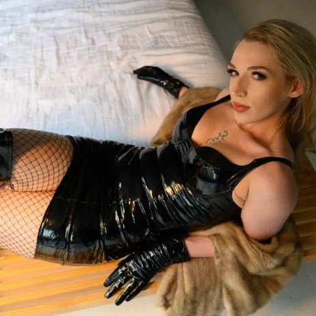 Surrender to Femdom Mistress Ruby Enraylls, expert Dominatrix. Leather Goddess, clad in fishnet, latex and fur. Indulge in your wildest fetish femdom fantasies