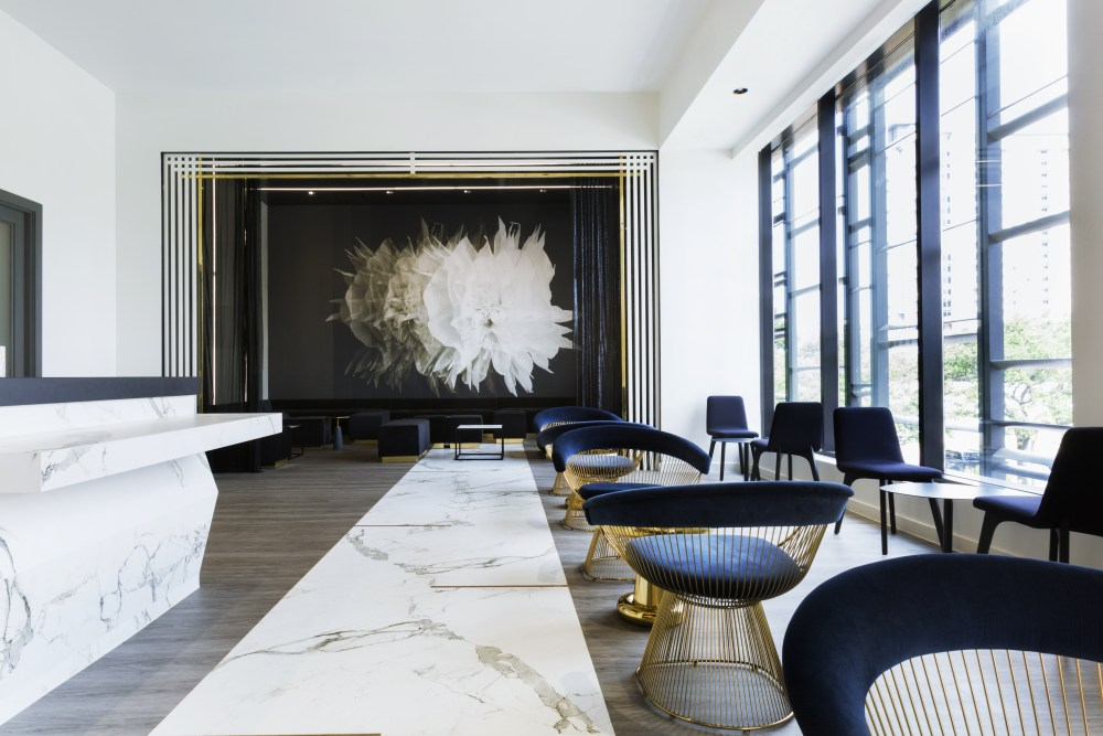 Neutrals and gold accents highlight the lines and luxury materials utilized in 5 star restaurant 51Fifteenth.