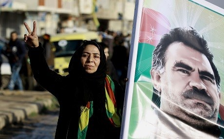 A Syrian Kurdish woman holds a portrait of jailed Kurdish leader Abdullah Ocalan during a rally in Qamishli, northern Syria, January 2017. File photo: AFP