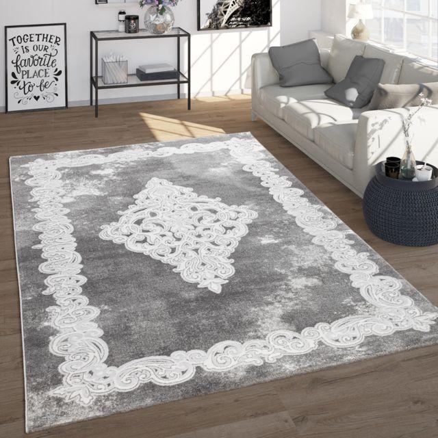 tapis de salon style oriental aspect vintage avec decorations poils ras gris