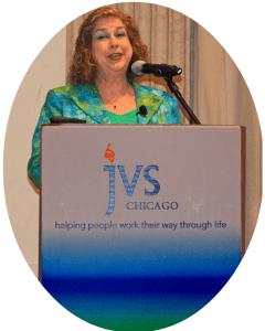 Image of Debra Ruh Standing behind a podium Speaking