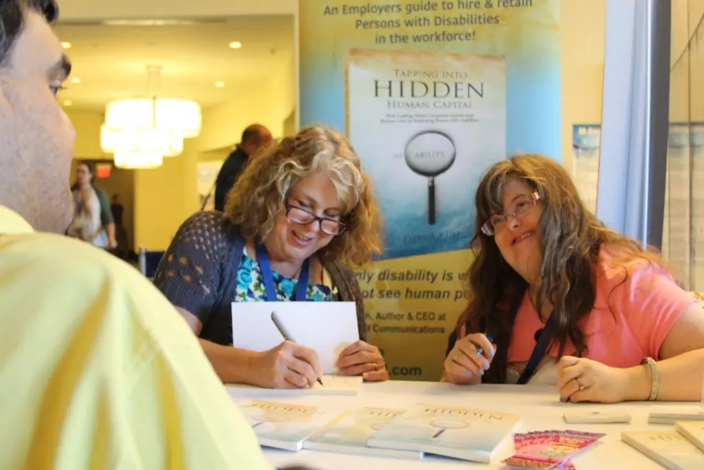 Photo of Debra and Sara Ruh at a Book signing for the release of Tapping Into Hidden Human Capital