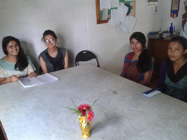 I am seated at the table with Prabriti (Rukmini Foundation Didi / Mentor), and two co-facilitators.