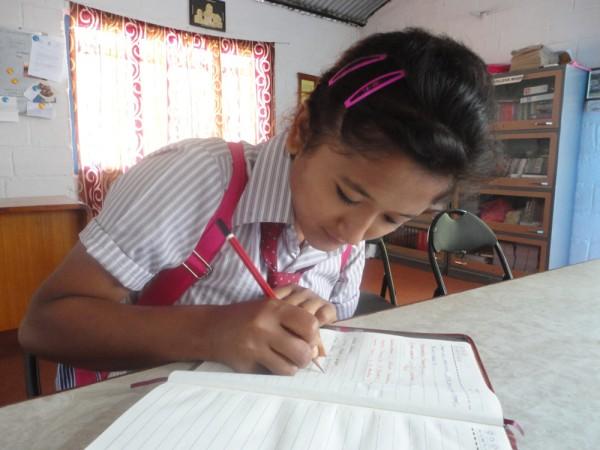 Anita giving contact numbers of teachers of her new school