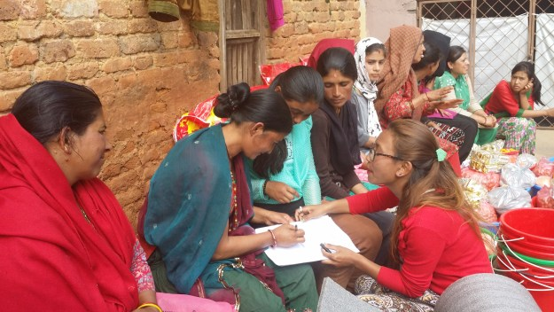 Rukmini Foundation's mentor Pramila collecting names of families receiving the relief goods.