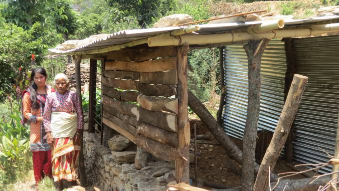 14 sabina and grandma of Saraswoti infront of their temp shed