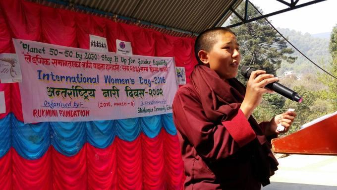 Program participant recites a poem on stage.