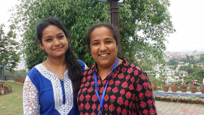 Ruku Graduate Scholar Sushmita takes the opportunity to take a photo with Puspa Didi