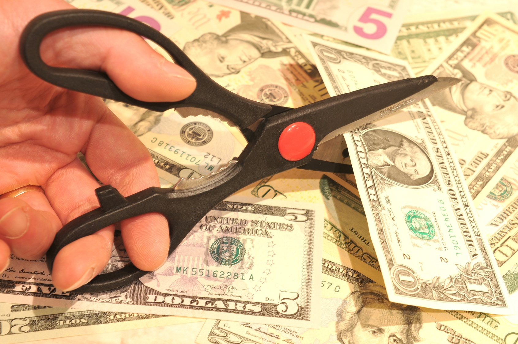 Budget Cut Concept With Scissors And Us Dollars Rulon T