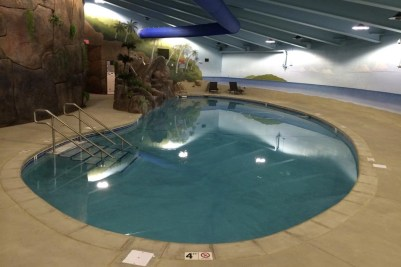 An indoor pool and rock climbing wall. (Photo: survivalcondo.com)
